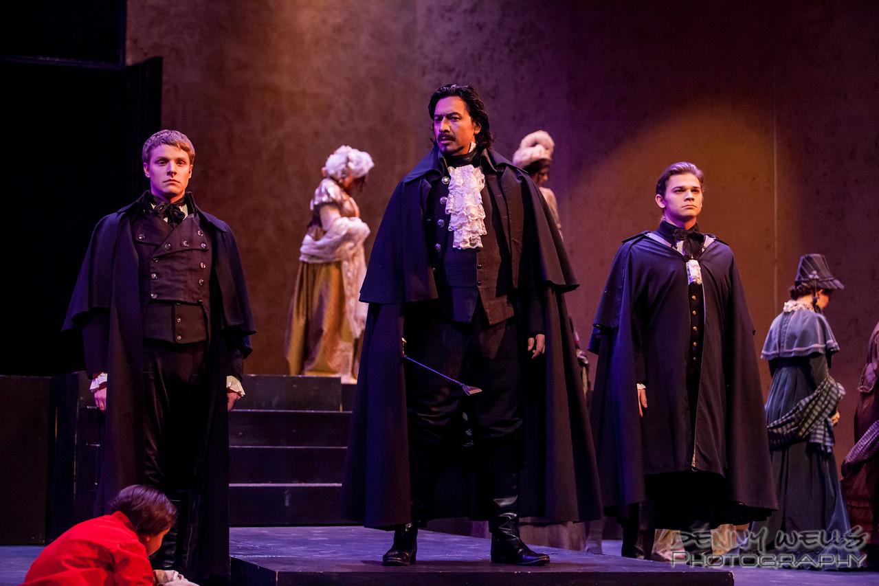 Scarpia (Luis Ledesma) and his henchmen Spoletta (Ben Robinson) and Sciarrone (Christopher Hall) disrupt the jubilant crowd.