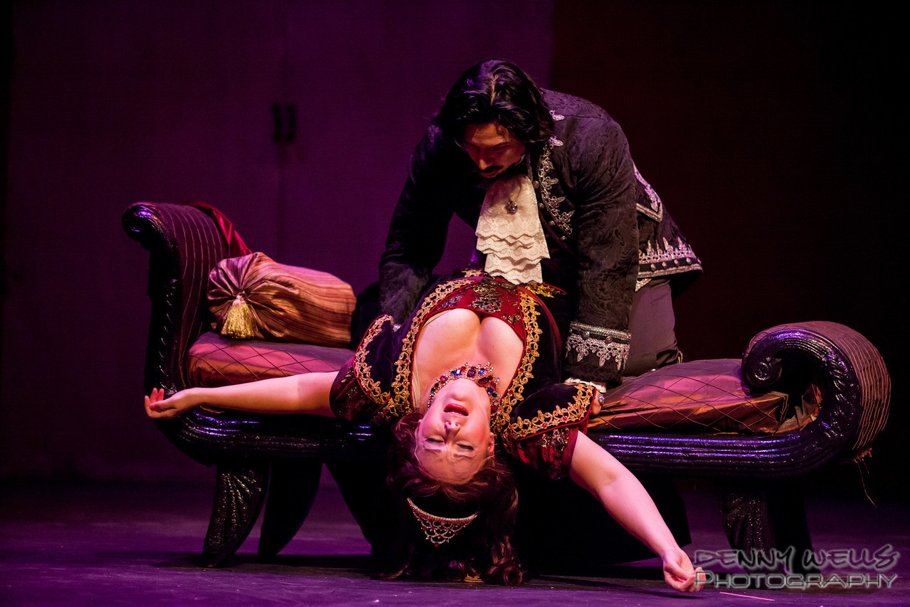 Scarpia (Luis Ledesma) trying to have his way with Tosca (Marie Plette)