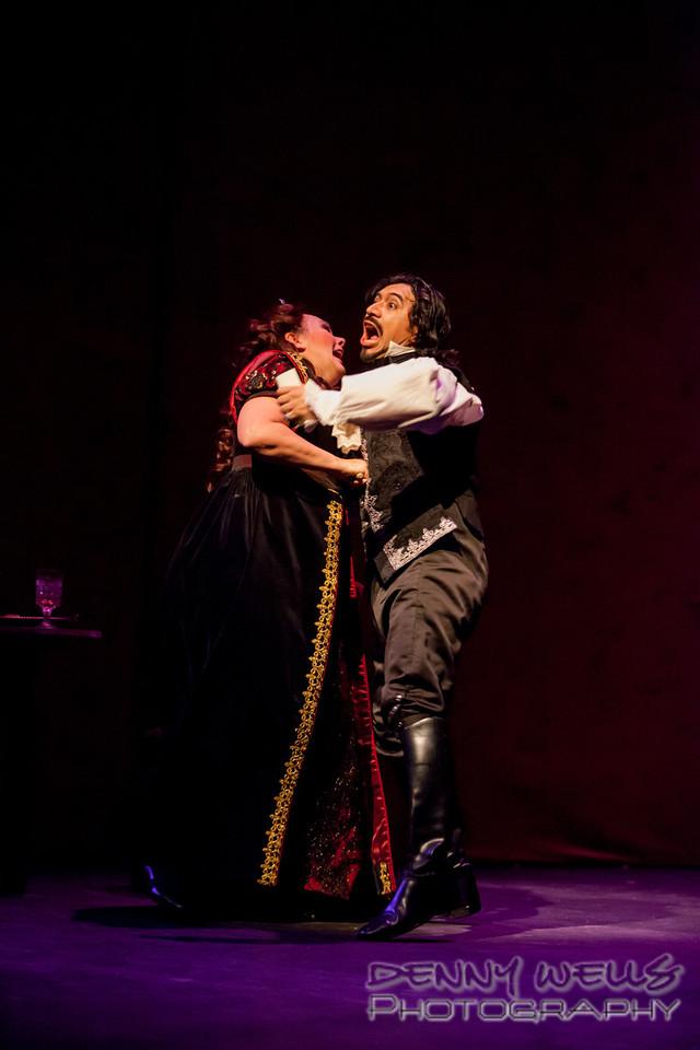 Tosca (Marie Plette) decides to use the knife on Scarpia (Luis Ledesma)