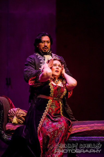 Scarpia (Luis Ledesma) describing the torture of Cavaradosi to Tosca (Marie Plette)