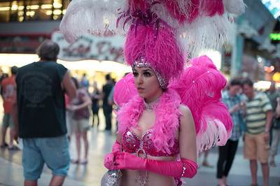 Photograph of Andrea Atayde Chavez on Fremont Street in showgirl costume in downtown Las Vegas by Las Vegas photographer Mark Bowers.  Copyright 2010 Mark Bowers All Rights Reserved