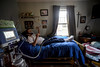 Andy Leclaire relaxes into bed for his afternoon nap on Wednesday, Dec. 9, 2015.. Kristopher Radder / Reformer Staff