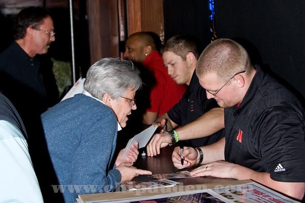 Graduating senior Jacob Hickman signs an autograph for a fan.