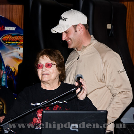 Chad Kelsay helps Joyce with the entertainment.