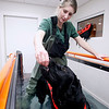 Record-Eagle/Jan-Michael Stump<br /> Erin Cox, a veterinary technician at Long Lake Animal Hospital, feeds a treat to Nelli, a newfoundland mix recovering from ACL surgery, during a break in an underwater treadmill session in the hospital's new Animal Rehabilitation Center of Northern Michigan. The center features a number of methods of care for animals' injuries, from laser treatments to an underwater treadmill.