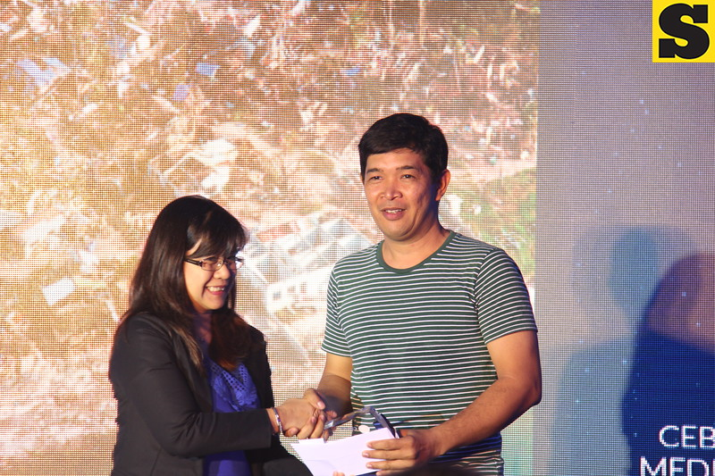 Photojournalist of the Year is Arni Aclao of Sun.Star Cebu
