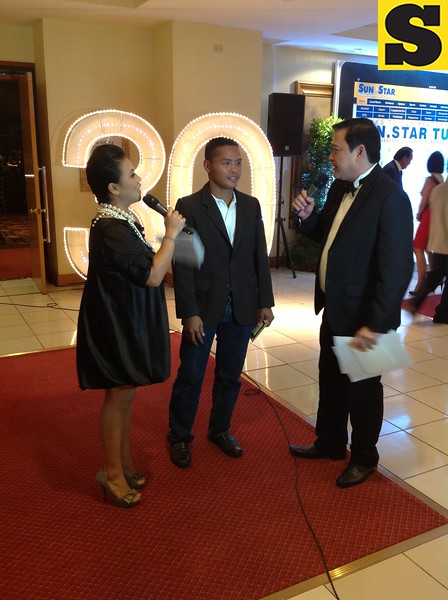 """Rey 'Boom Boom"""" Bautista of the ALA Boxing Promotions with hosts April Rama and Vince Escario."""