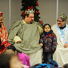 "Edwin Hernandez, 4, of Fitchburg poses for a photo with the ""3 Kings,"" from left, former Cleghorn Neighborhood Center youth director Jason Jordan, 24, of Ayer, past CNC board president Nathan Bilotta of Fitchburg, and State Rep. Stephen DiNatale, Thursday night during the Cleghorn Neighborhood Center's annual 3 Kings event at the Saint Joseph Church in Fitchburg.<br /> SENTINEL & ENTERPRISE / BRETT CRAWFORD"