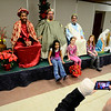 "Scott Barboro of Fitchburg takes a photo of (from left) Merelin Delarosa, 8, of Fitchburg and his step-daughters Jasmine Cormier, 7, and Haleigh Cormier, 9, both of Fitchburg with the ""3 Kings,"" from left, former Cleghorn Neighborhood Center youth director Jason Jordan, 24, of Ayer, past CNC board president Nathan Bilotta of Fitchburg, and State Rep. Stephen DiNatale, Thursday night during the Cleghorn Neighborhood Center's annual 3 Kings event at the Saint Joseph Church in Fitchburg.<br /> SENTINEL & ENTERPRISE / BRETT CRAWFORD"