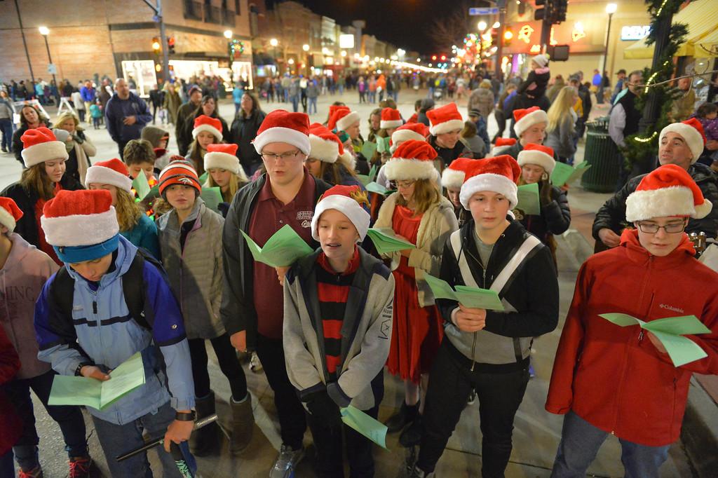 Justin Sheely | The Sheridan Press<br /> Sheridan Junior High School students sing carols during the annual Christmas Stroll Friday in downtown Sheridan.
