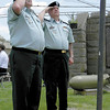 Dan Irwin/NEWS<br /> Jim Butera, left, and Anthony Camerot salute the Stars and Stripes after raising the flag at yesterday's Croton Honor Roll ceremony.