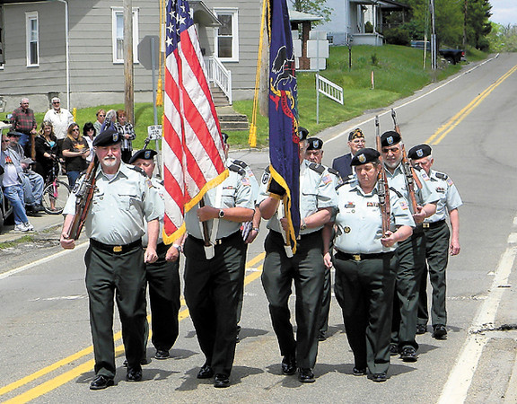 Dan Irwin/NEWS<br /> Members of the New Castle Area Honor Guard parade down Eastbrook Road prior to the raising of the flag at yesterday's Croton Honor Roll ceremony.