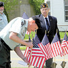 Dan Irwin/NEWS<br /> Leonard Sanillo, right, and Jim Leopardo perform a presentation of flags during the roll call of honor at yesterday's Croton Honor Roll service.