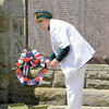Virginia Hamilton, president of AMVETS Post 281 Auxiliary, presents a wreath at the honor roll. — Dan Irwin