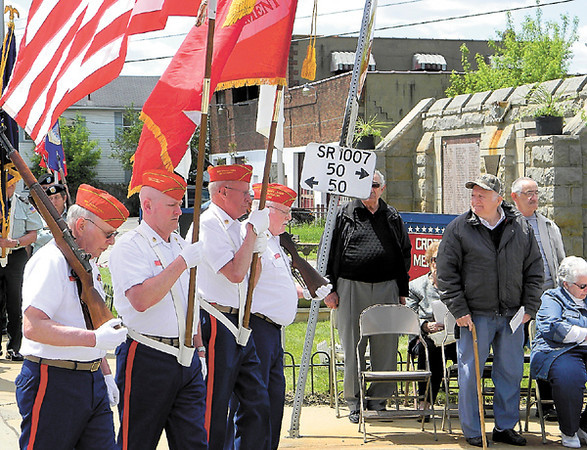 Veterans comprising a color guard step off to parade around the Croton Honor Roll prior to the raising of the flag. — Dan Irwin