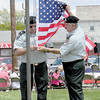 Jim Butera and Anthony Camerot prepare to raise the flag. — Dan Irwin