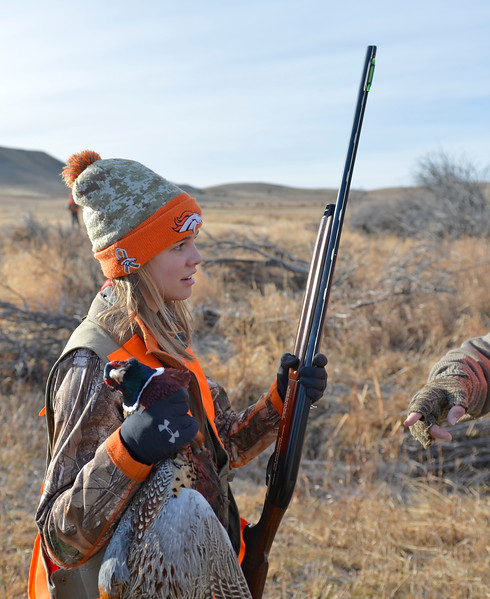 Justin Sheely | The Sheridan Press<br /> Fourteen-year-old Libby Franklin holds her first pheasant during the 5th-annual Kids' Pheasant Hunt Saturday at Fort Phil Kearny State Historic Site. The event provides an opportunity for youth to learn and practice safe hunting skills with experienced adults.