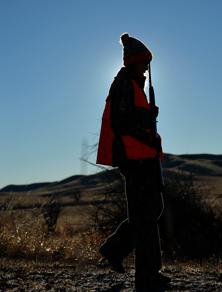 Justin Sheely | The Sheridan Press<br /> Fourteen-year-old Libby Franklin keeps her shotgun barrel pointed up as her dog runs ahead during the 5th-annual Kids' Pheasant Hunt Saturday at Fort Phil Kearny State Historic Site. The event provides an opportunity for youth to learn and practice safe hunting skills with experienced adults.