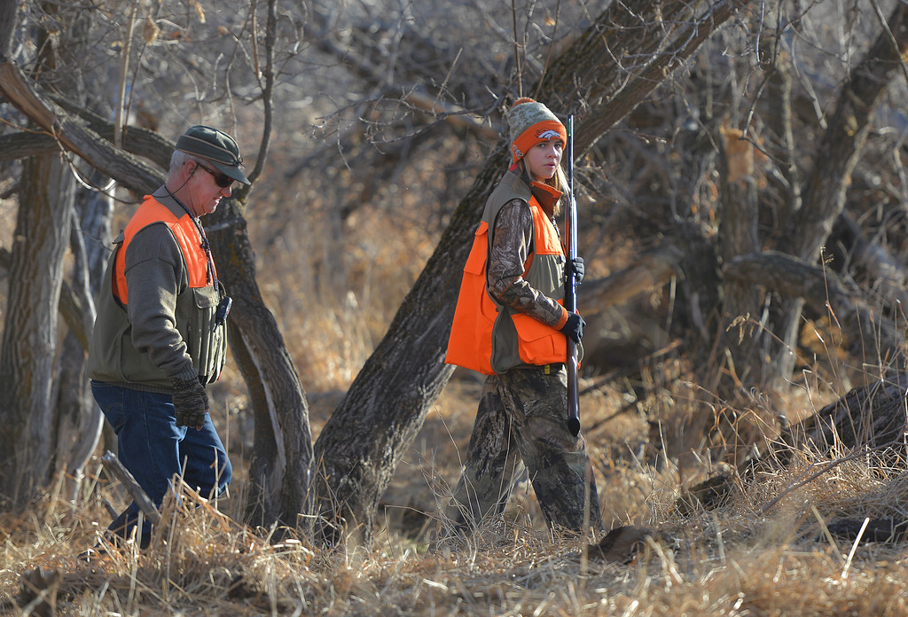 Justin Sheely | The Sheridan Press	<br /> Fourteen-year-old Libby Franklin, right, and grandparent Scott Terry search the area during the 5th-annual Kids' Pheasant Hunt Saturday at Fort Phil Kearny State Historic Site. The event provides an opportunity for youth to learn and practice safe hunting skills with experienced adults.