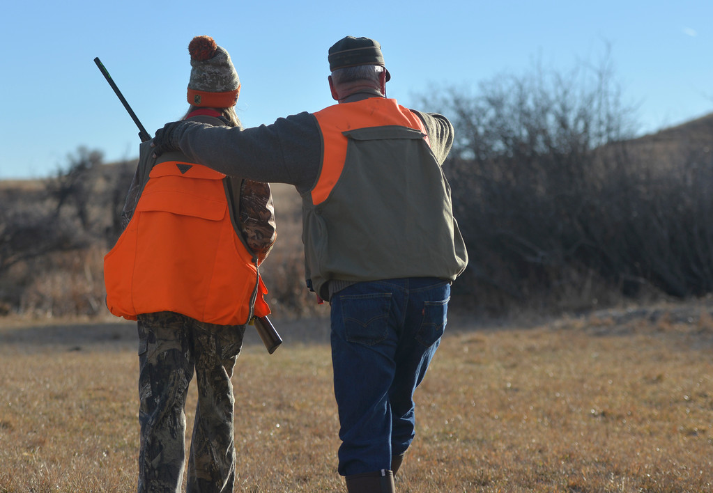 Justin Sheely | The Sheridan Press	<br /> Fourteen-year-old Libby Franklin, left, and grandparent Scott Terry spot a pheasant during the 5th-annual Kids' Pheasant Hunt Saturday at Fort Phil Kearny State Historic Site. The event provides an opportunity for youth to learn and practice safe hunting skills with experienced adults.