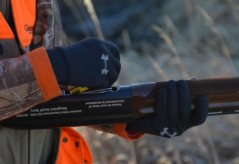 Justin Sheely | The Sheridan Press<br /> Fourteen-year-old Libby Franklin loads a shell during the 5th-annual Kids' Pheasant Hunt Saturday at Fort Phil Kearny State Historic Site. The event provides an opportunity for youth to learn and practice safe hunting skills with experienced adults.