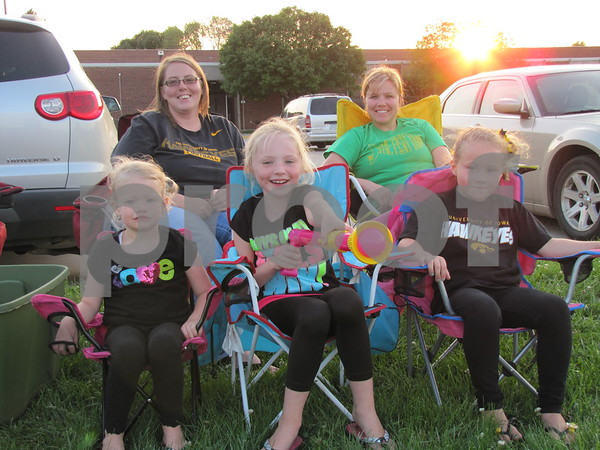 Lindsay Underberg and Jenny Andrew (in rear), and Olivia Andrew, Ava Underberg, and Ave Andrew are ready to watch fireworks.