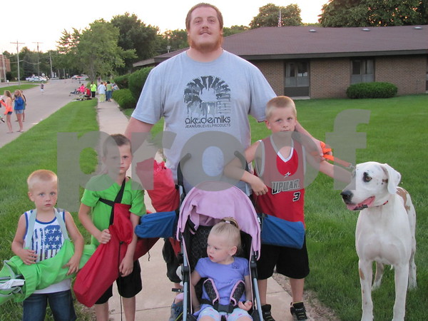 Patrick Schamlen and his children Mark, Parker, Rory, and Amelia (in stroller), and their dog Rowdy were looking for a good spot to settle in and watch fireworks put on by the Marian Home.