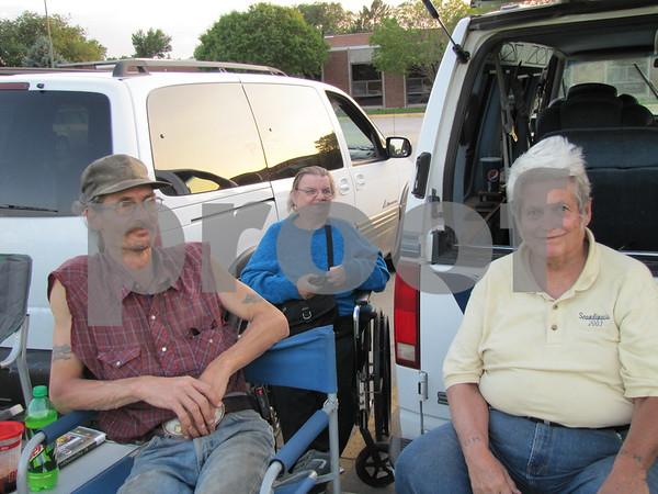 Jack Hook, Diane Hoban, and Denny Hoban at the Marian Home fireworks display.