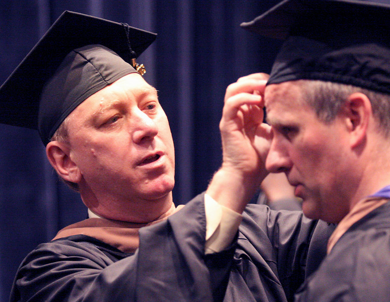 E.L. Hubbard Photography<br /> David Davis helps John Dwyer with his mortar board before the Antioch University McGregor Commencement 2008 at the Schuster Center Sunday, June 29, 2008.