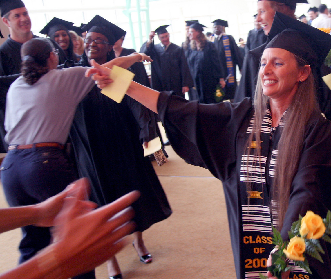 E.L. Hubbard Photography<br /> Sheila McBride runs to get a hug during the Academic Processional at the Antioch University McGregor Commencement 2008 at the Schuster Center Sunday, June 29, 2008.