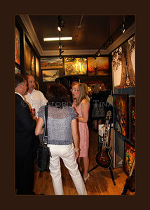 A meet and mingle moment at the Re-Opening of Antony's Gallery with Antony and Shannon Von Palleske ... July 7, 2011