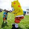 5/14/16 LEOMINSTER-- Birthday boy Mason Antonucci of Westminster, who just turned 4, hanging with Spongebob on Saturday during the Apple Blossom Festival at Sholan Farm in Leominster.  Sentinel & Enterprise photo/Jeff Porter