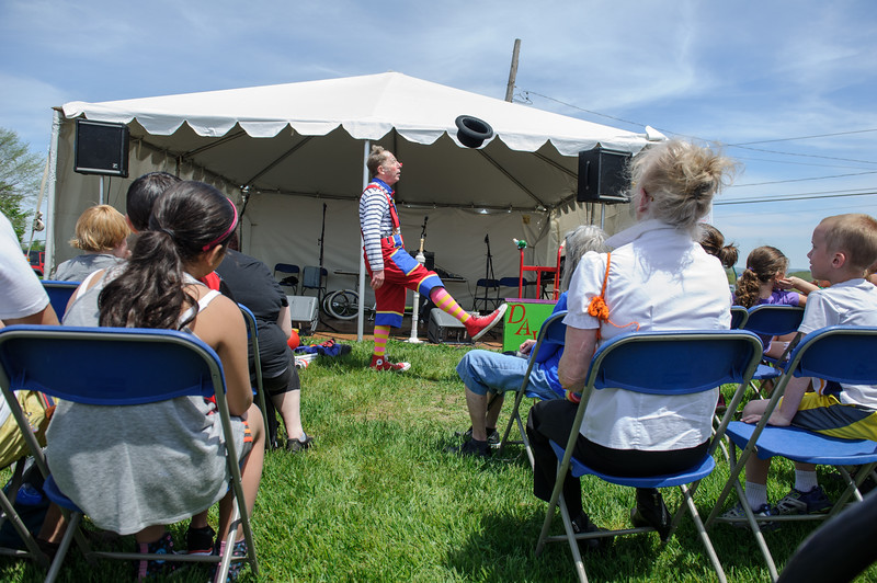 5/14/16 LEOMINSTER-- Davey the Clown, or David Holzman of Roslindale performing for families on Saturday during the Apple Blossom Festival at Sholan Farm in Leominster.  Sentinel & Enterprise photo/Jeff Porter
