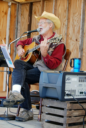 Sam Luptak Jr./NEWS<br /> <br /> Rick Bruening sang, played guitar and told stories to entertain Saturday's Fall Harvest Festival and Craft Fair crowd.