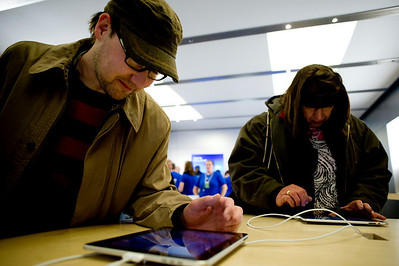 Jason Keller, of Boulder, plays with the new Apple I PAD at the Apple Store in the Twenty Ninth Street Mall in Boulder, Saturday, April 3, 2010. The i Pad went on sale Saturday morning.   DAILY CAMERA/KASIA BROUSSALIAN  For a video of the event, please visit www.dailycamera.com