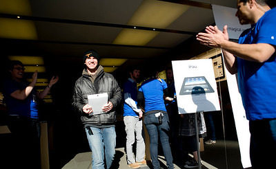 Blake Kobelan, visiting from Texas, walks out carrying the second sold i Pad of the day at the Apple Store in the Twenty Ninth Street Mall in Boulder, Saturday, April 3, 2010.  DAILY CAMERA/KASIA BROUSSALIAN  For a video of the event, please visit www.dailycamera.com
