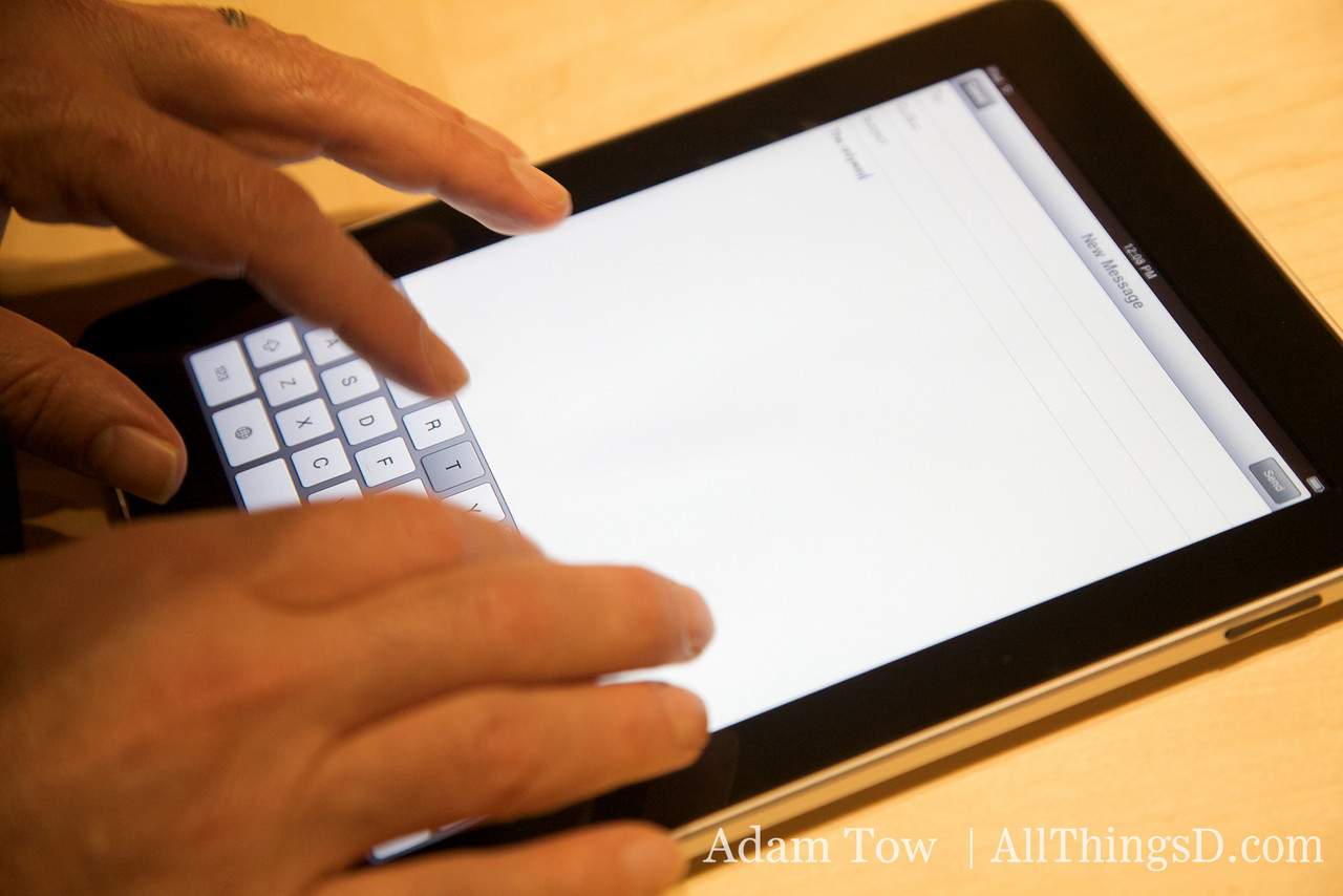 Typing using the soft keyboard on the iPad.