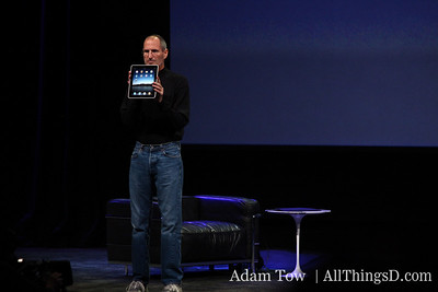 Steve Jobs shows off the new iPad.