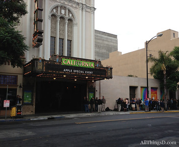 Reporters queue outside the California theater in San Jose for Apple's invite-only event Oct. 23.
