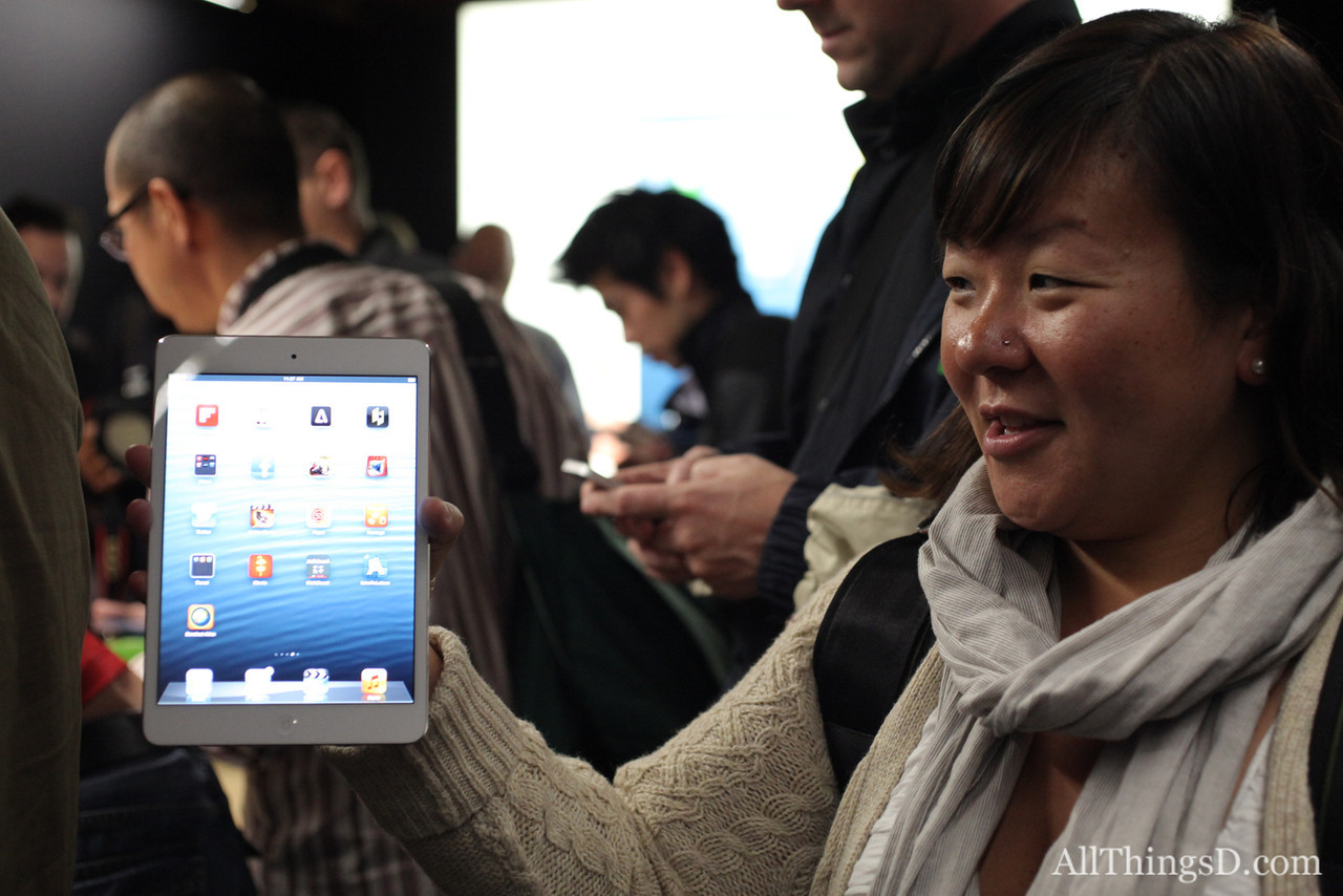 AllThingsD product reviewer Bonnie Cha holds up the iPad mini...