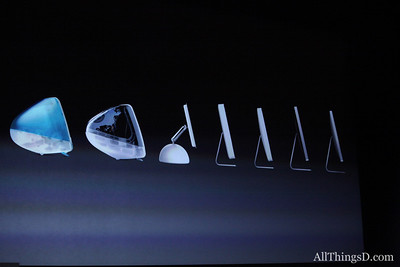 "On to desktops: Schiller showed an ""evolution of man""-style progression of past iMacs."