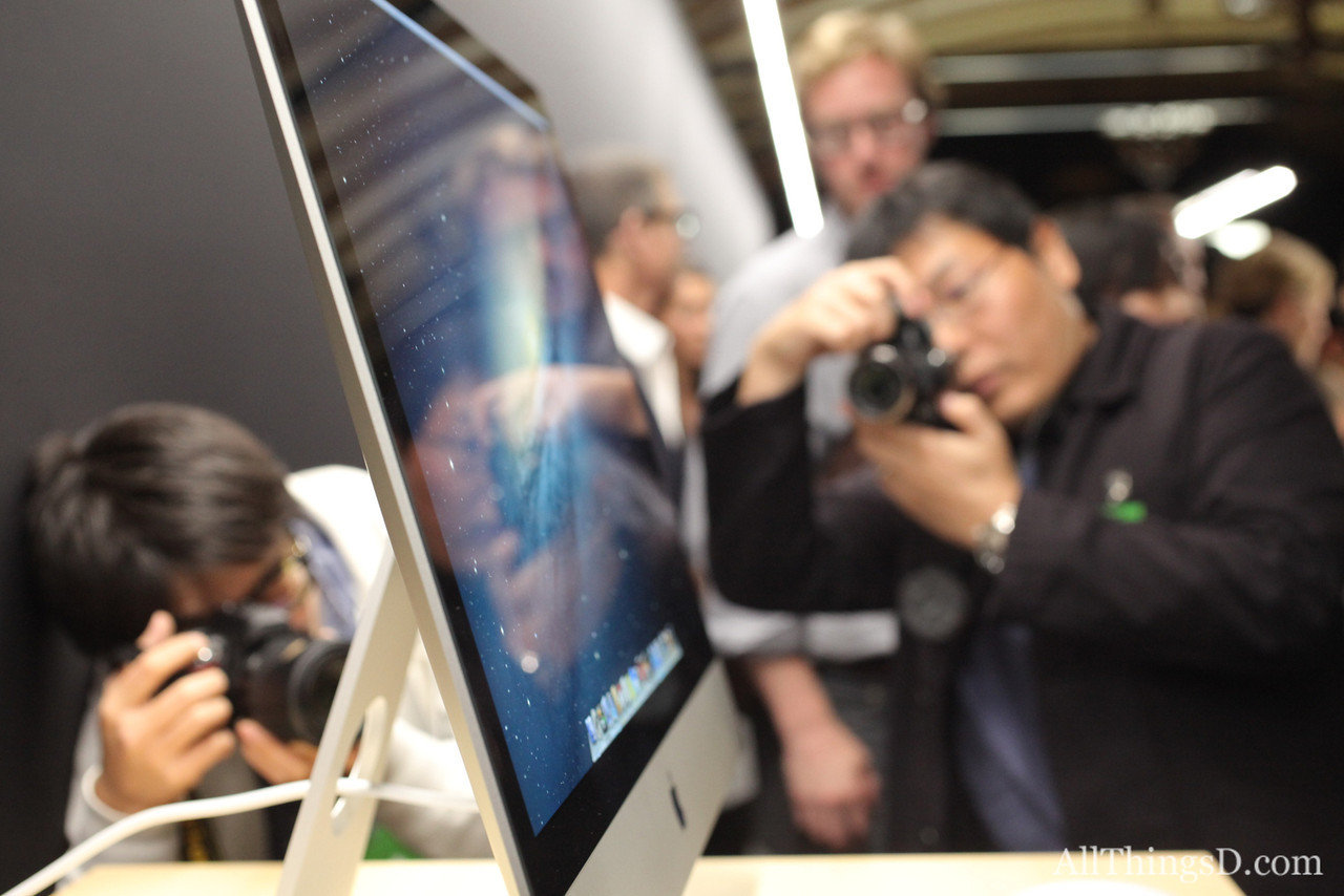Reporters photograph the new desktop from all angles.