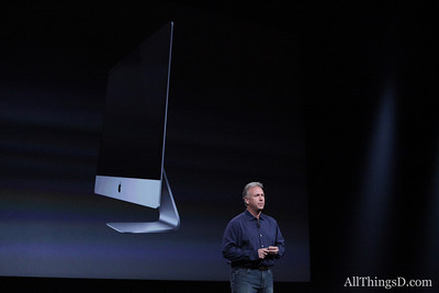 One of the day's surprises: a new, thinner iMac.