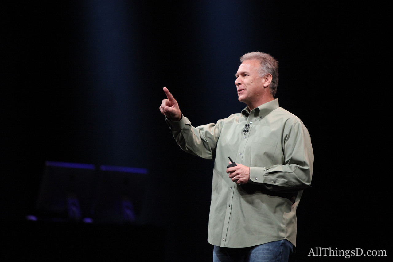 As he took the stage to talk iPhone, Phil Schiller admired the glowing Apple logos in front of him.