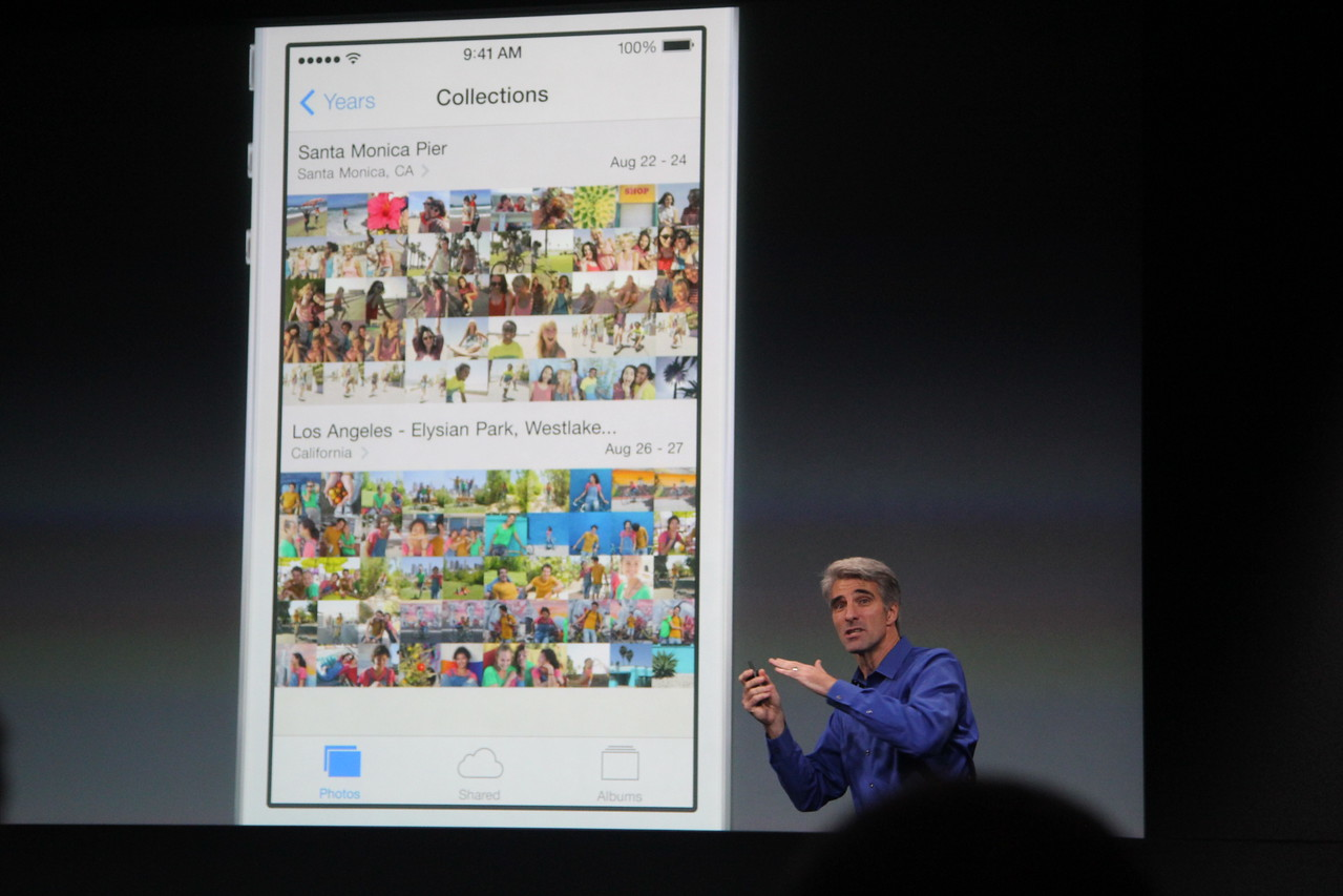 """The new photos app automatically sorts pictures into """"moments,"""" he said."""