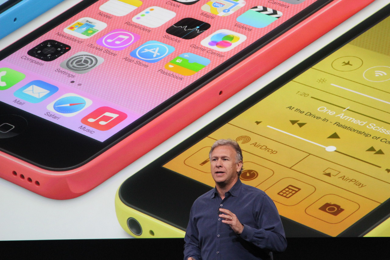 Schiller talks about the phones' design in front of a slide showing them close-up.