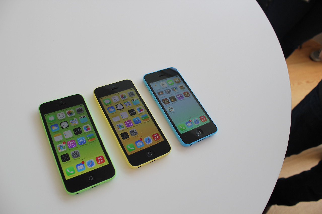 Three iPhone 5Cs lined up together.