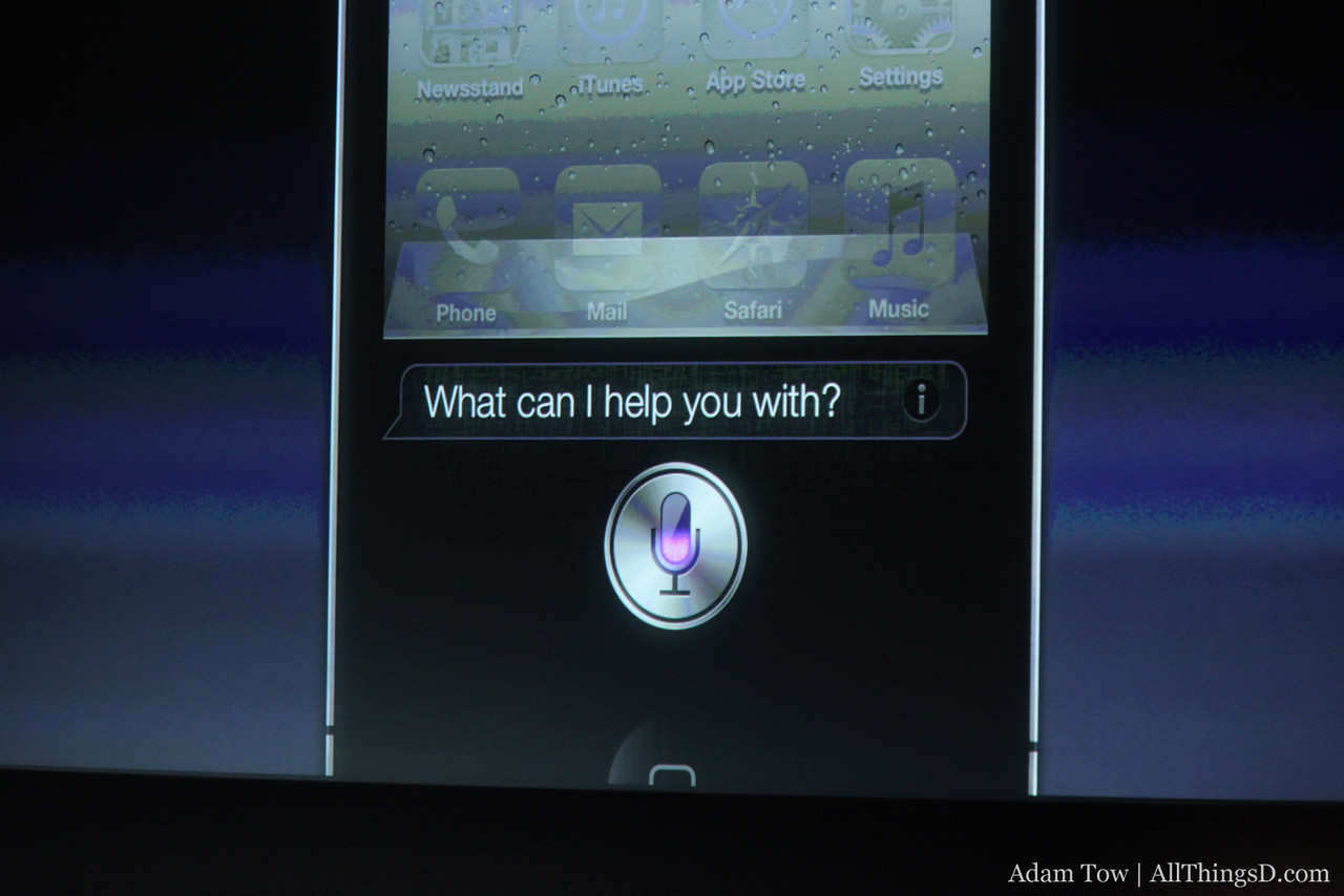 Press the home button and Siri appears.