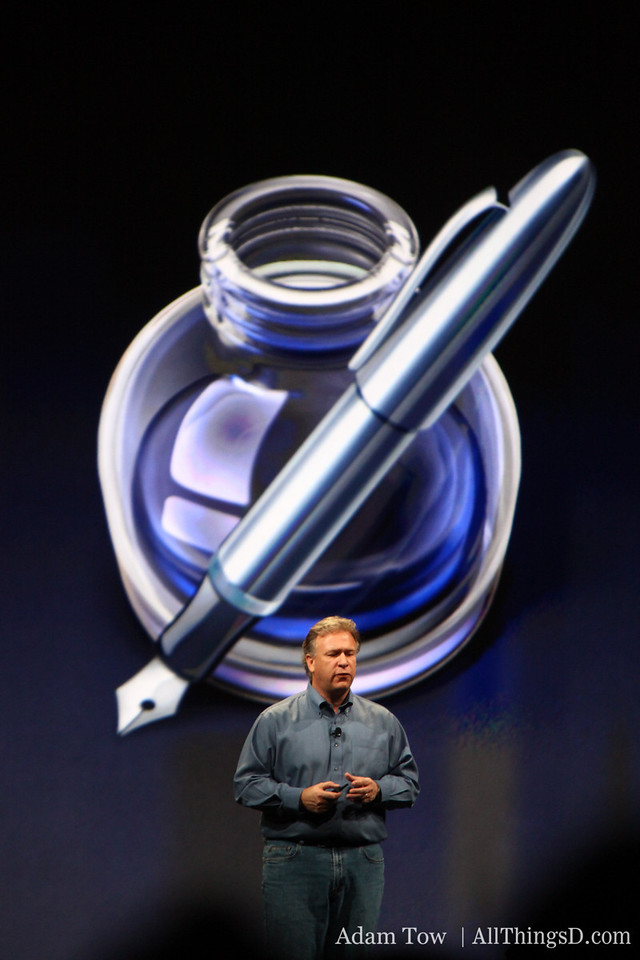 Phil Schiller standing in front of the Pages icon from iWork 09.
