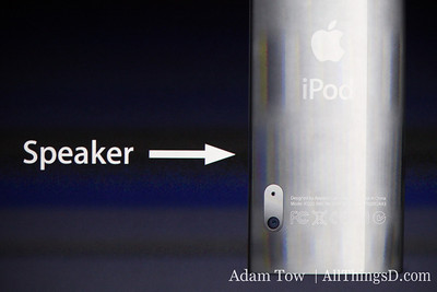 The camera lens and speaker are on the back of the device.